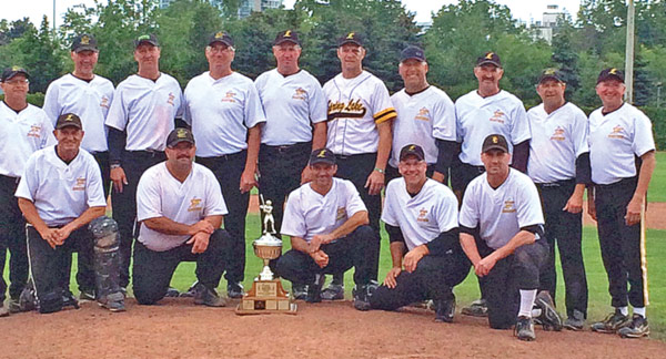 The 2014 Spring Lake Masters team took home first place at the Canadian National Oldtimers Baseball Championships earlier this month in Brampton, Ontario. Back row (from left): Darcy Meyer, Ron Zimer, Curtis Schurger, Dave Curtis, Kelly Zimmer, Bye Braun, Don Oslund, Kevin Zimmer, Randy Greenwall, Doug Zimmer. Front row (from left): Reg Zimmer, Bill Zimmer, Pete LeDoux, Sid Wells, Grayden King.